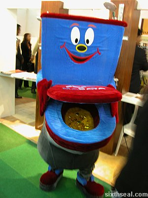 blue grinning fluffy toilet