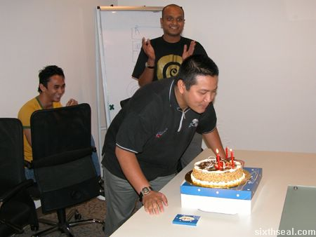 rashidin_blowing_candles.jpg