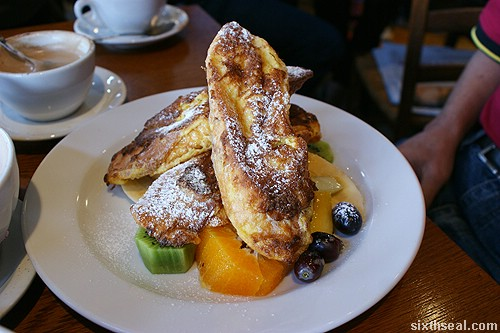 French Toast served with fresh fruit and mixed berry maple compote