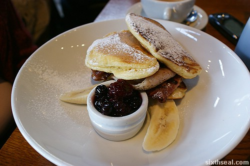 Pancake Stack with banana, crispy bacon, maple syrup and berry compote