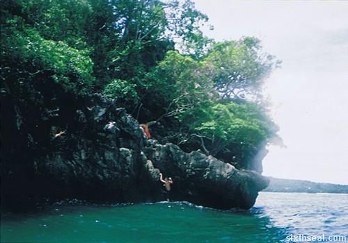 cliff diving climbing