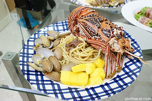 lobster and clam pasta with mango